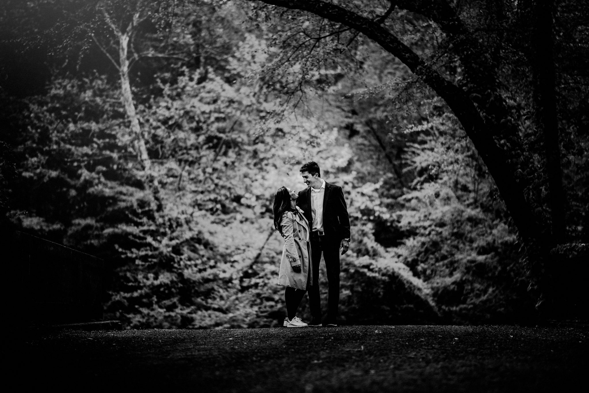 black and white image of couple after surprise proposal
