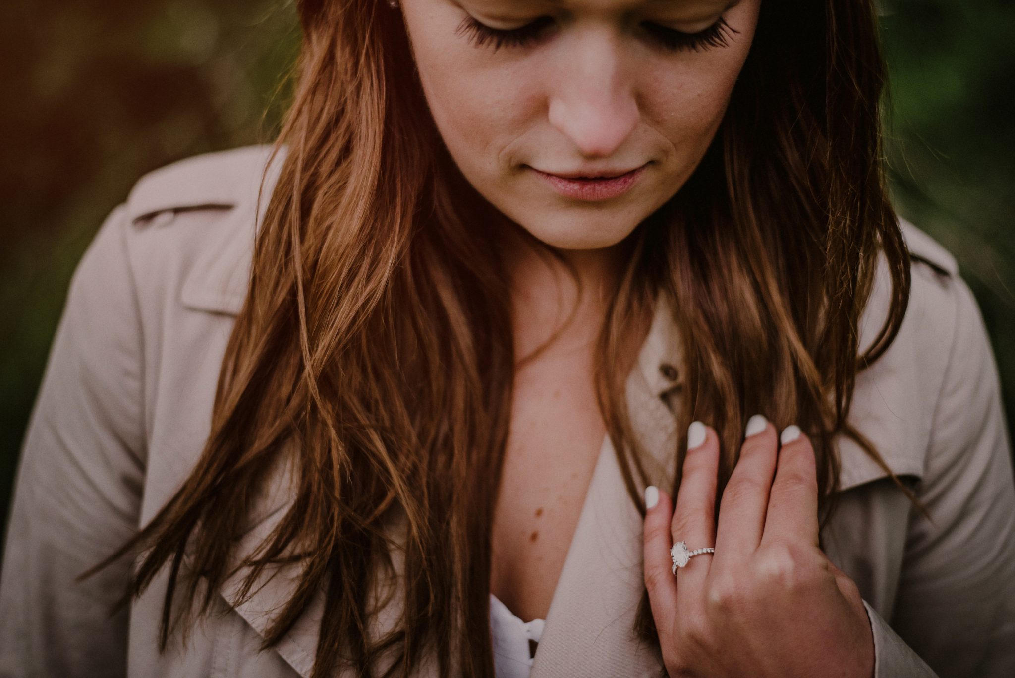 artistic portrait of newly engaged girl