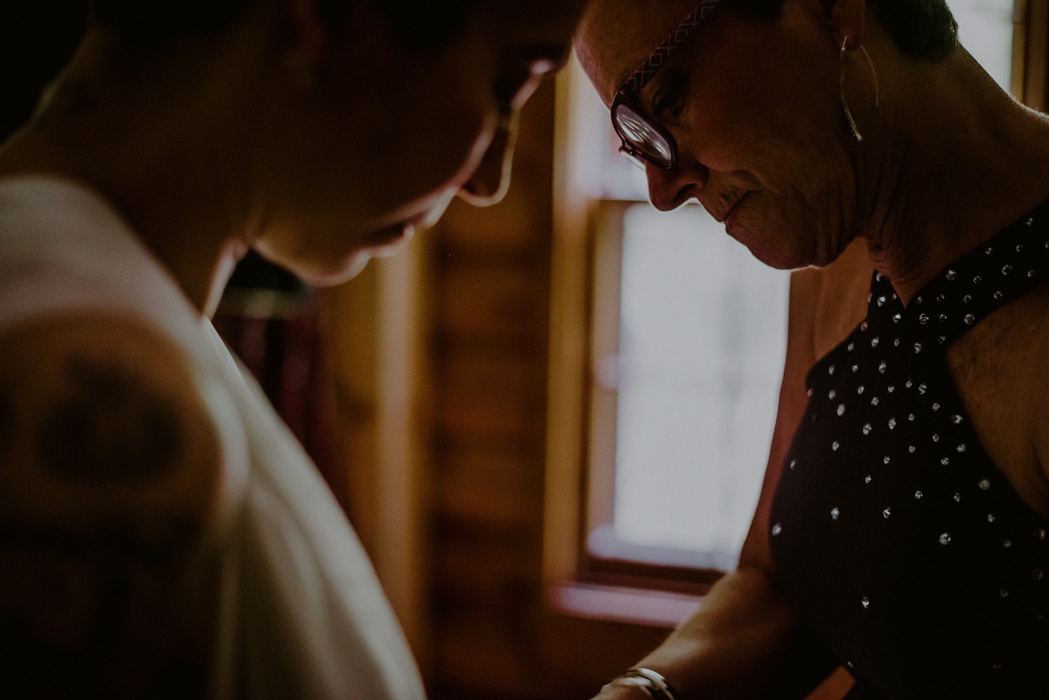 intimate wedding photos while bride gets dressed at mother's house in nj
