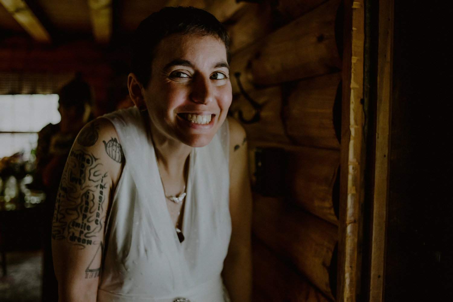 tattooed bride smiles and prepares for first look