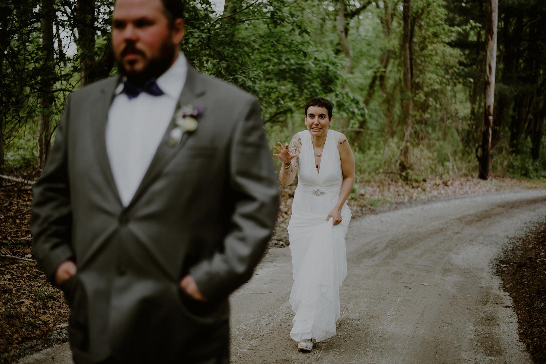 wedding first look between bride and groom in the woods
