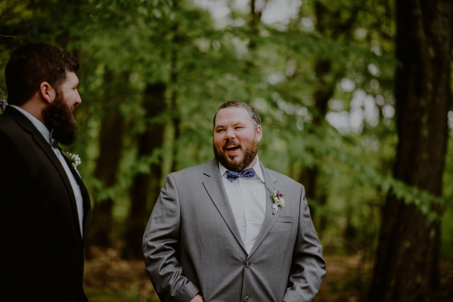 happy groom waits during backyard wedding ceremony