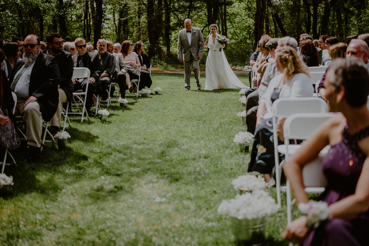 bride walks down aisle in DIY NJ backyard wedding ceremony