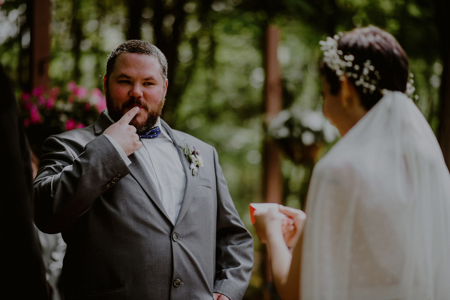 candid wedding photos of groom during ceremony