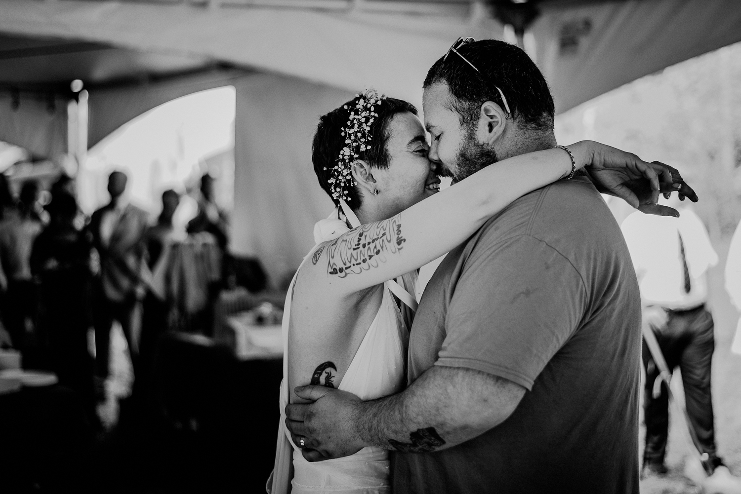 bride and groom first dance under tented backyard wedding reception
