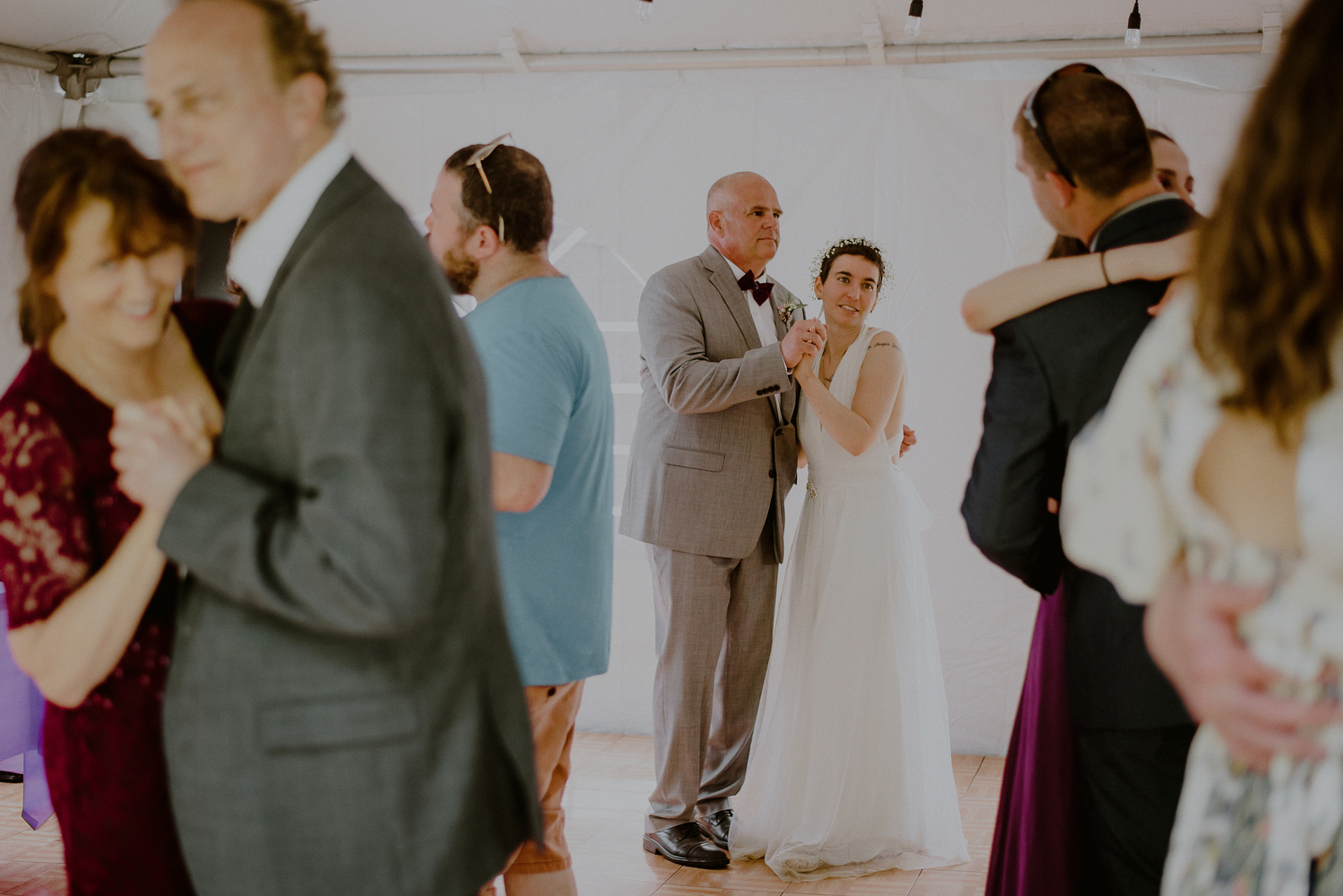 bride and father dance in daytime tented wedding reception