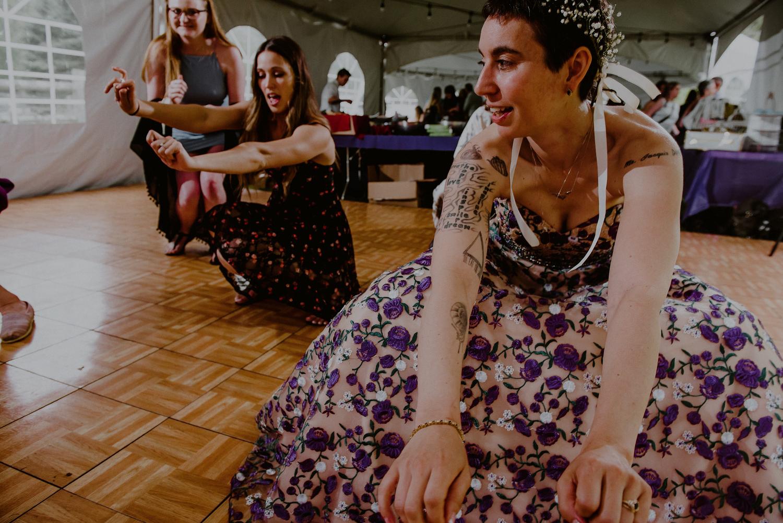 candid dance floor scenes from tented wedding