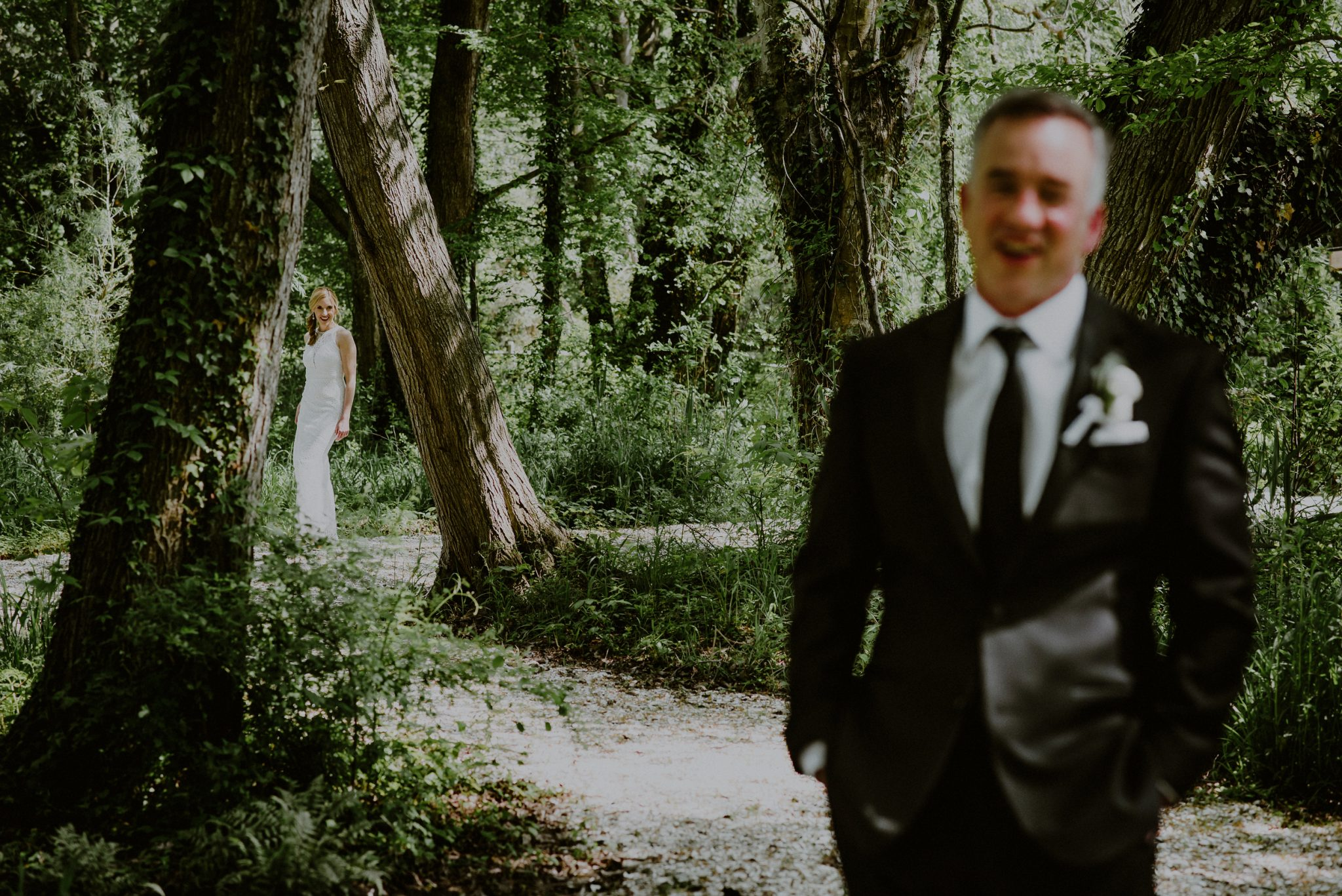 bride and groom first look in the woods of beach plum farm