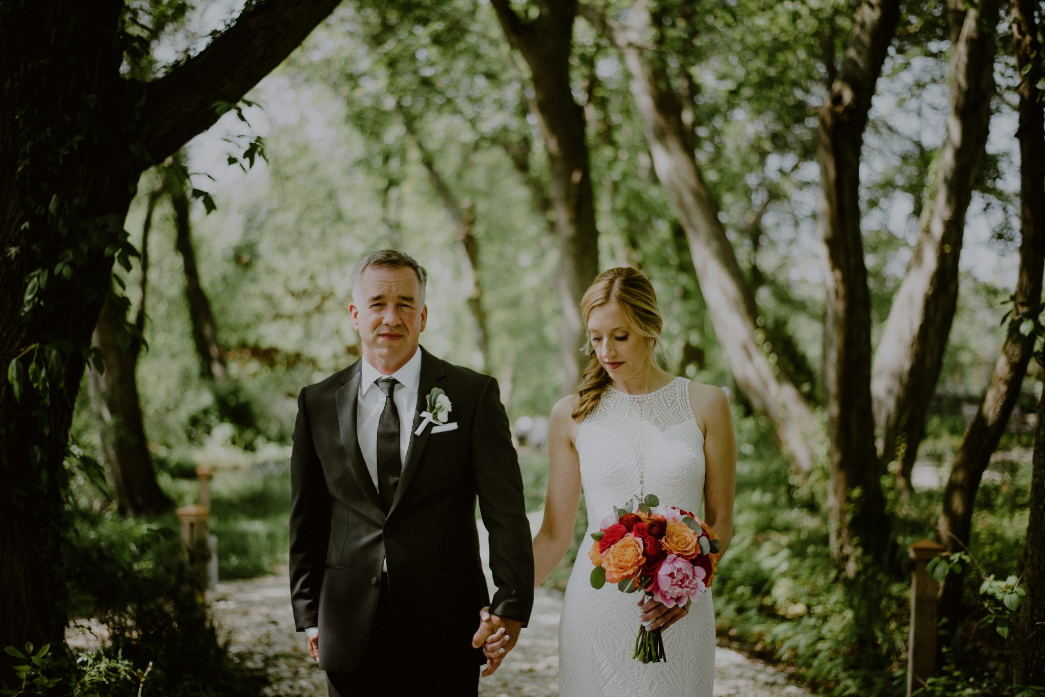portrait of bride and groom in woods of beach plum farm