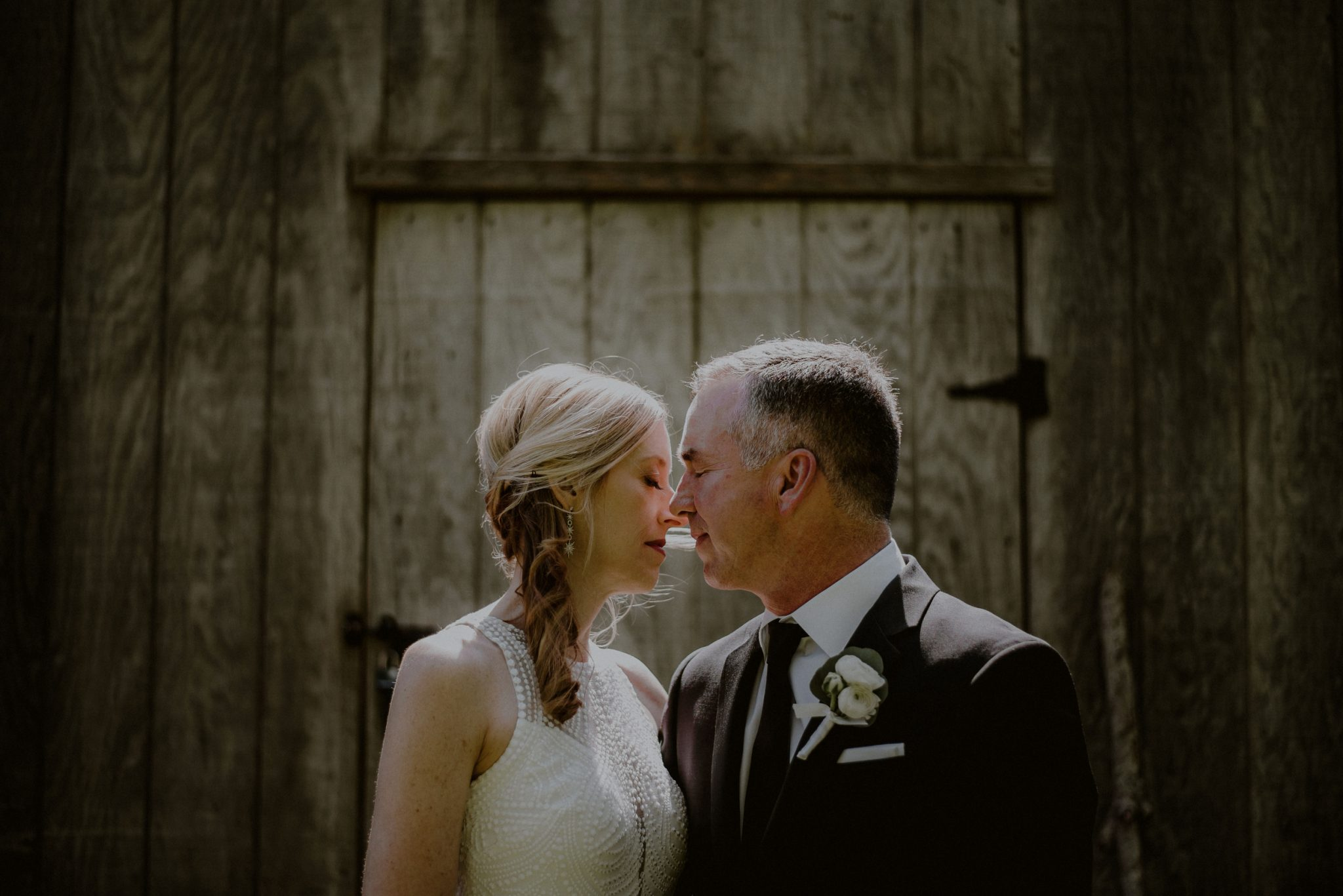 emotional wedding portrait of bride and groom