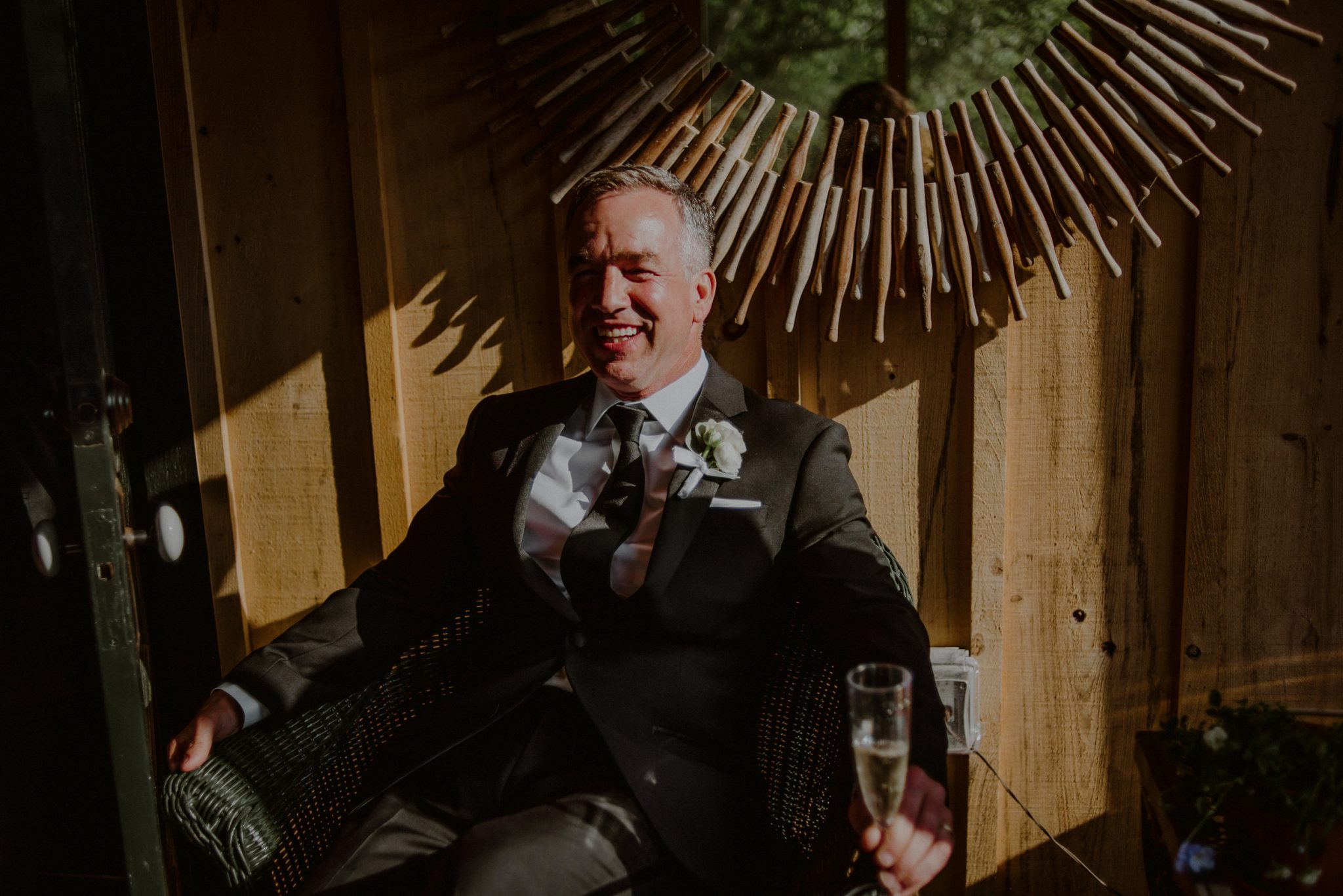 candid photo of relaxed groom