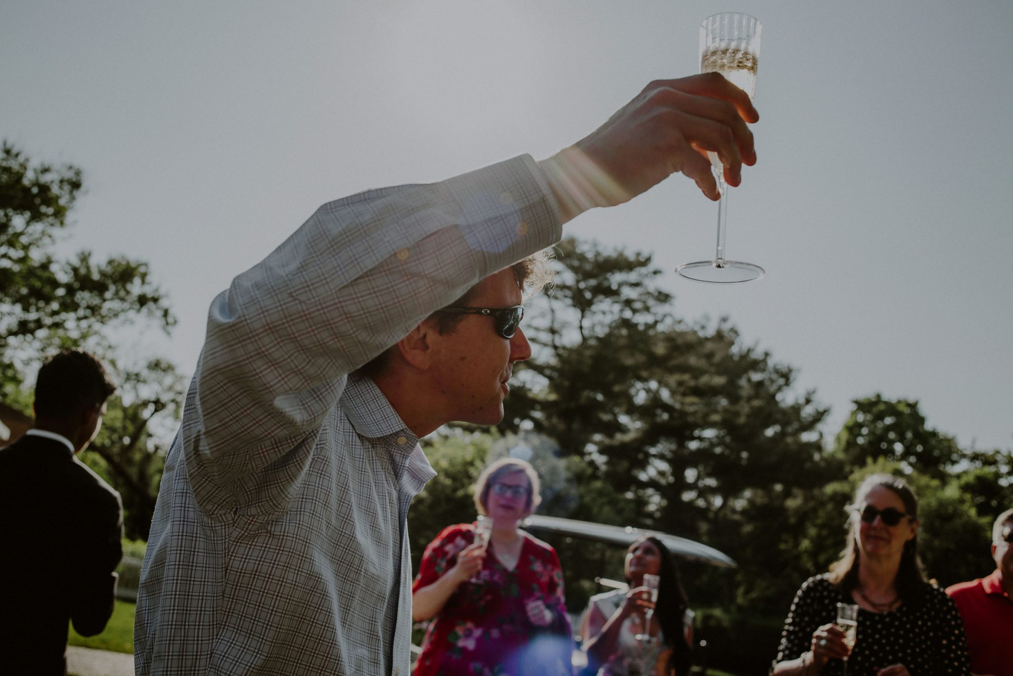 champagne toast at backyard wedding