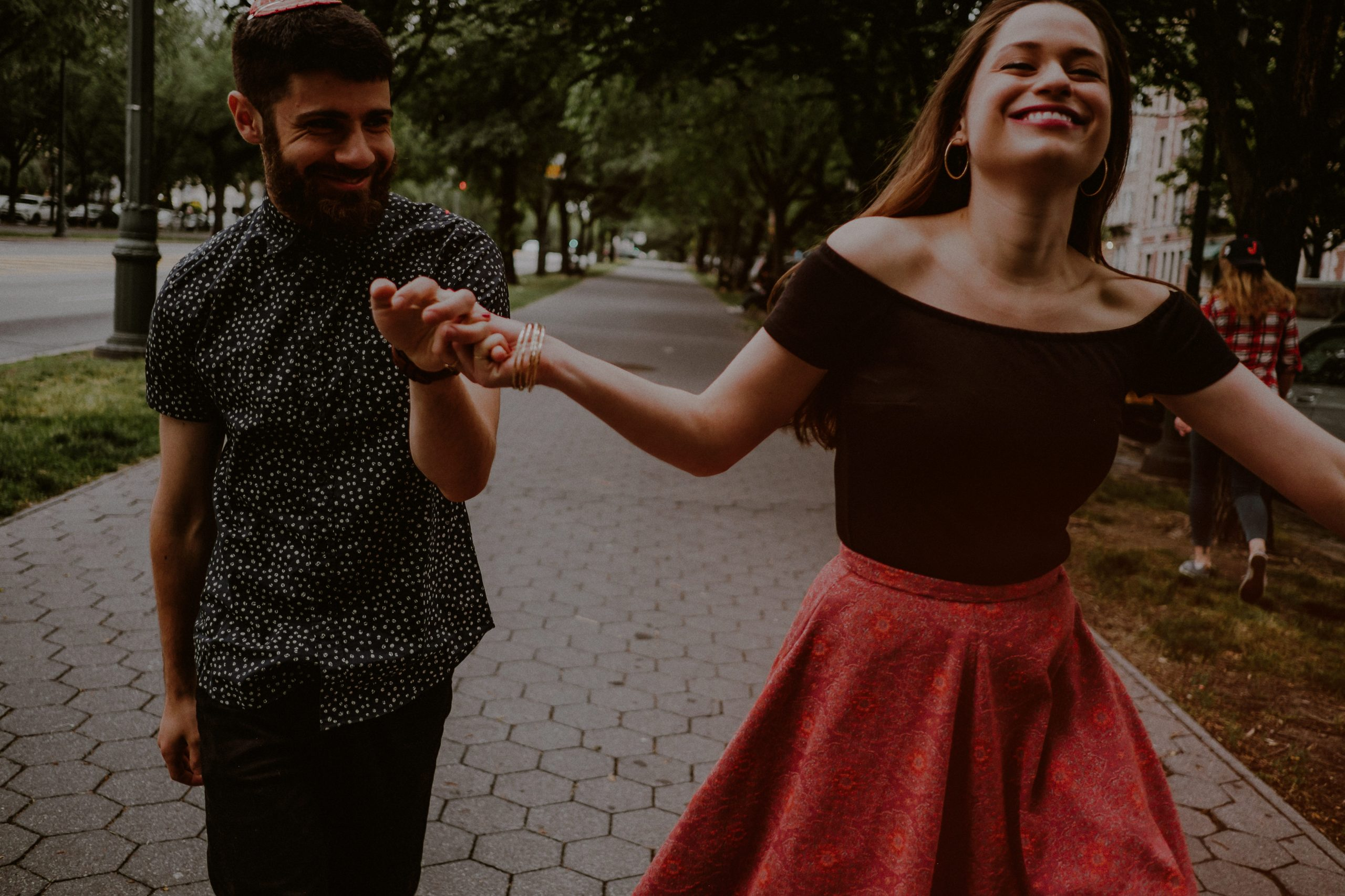 engaged couple dances on streets of brooklyn ny